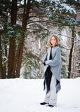 Girl in a snowy forest. Twelve year old girl outdoors in winter in a forest covered in snow Stock Image
