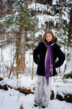 Girl in a snowy forest. Twelve year old girl outdoors in winter in a forest covered in snow Royalty Free Stock Photography