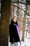 Girl in a snowy forest. Twelve year old girl outdoors in winter in a forest covered in snow Royalty Free Stock Photos