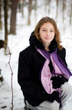 Girl in a snowy forest. Twelve year old girl outdoors in winter in a forest covered in snow Stock Photo