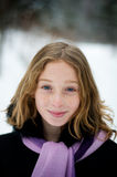 Girl in a snowy forest. Twelve year old girl outdoors in winter in a forest covered in snow Stock Photography