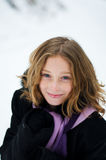 Girl in a snowy forest. Twelve year old girl outdoors in winter in a forest covered in snow Royalty Free Stock Image