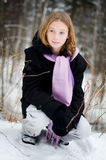 Girl in a snowy forest Royalty Free Stock Images