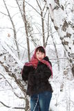 Girl in a snowy forest. Near the birches Royalty Free Stock Photography