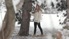 Girl in the snowy forest. A lot of snow stock footage