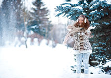 Girl in snowy forest royalty free stock photo