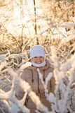 Girl in the snowy forest Stock Image