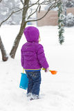 Girl in snowy front yard royalty free stock photos