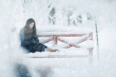 Girl in snowy park Stock Images
