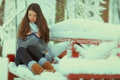 Girl in snowy park Royalty Free Stock Photo