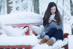 Girl in snowy park Royalty Free Stock Photos