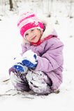 Girl at snowy winter outdoors Royalty Free Stock Image