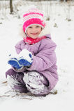 Girl at snowy winter outdoors Stock Image
