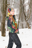 Girl in snowy winter outdoors Stock Photo