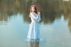 Girl soaked clothes in the lake water. Royalty Free Stock Images