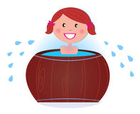 A girl soaking in cold barrel tub after sauna Royalty Free Stock Images