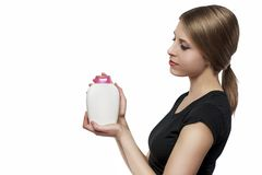 Girl with soap. Beautiful girl with bottle of soap isolated on white Royalty Free Stock Photo