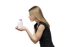Girl with soap. Beautiful girl with bottle of soap isolated on white Stock Photography