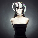 Girl with soap bubble. Beautiful woman with big soap bubble. Conceptual photo
