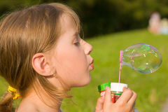 Girl and a soap bubble Royalty Free Stock Images