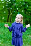 Girl and soap bubbles Royalty Free Stock Image