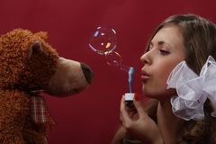 Girl with a soap bubbles Royalty Free Stock Photo