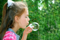 Girl with soap-bubbles Royalty Free Stock Photos