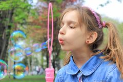 Girl with soap bubbles Royalty Free Stock Image