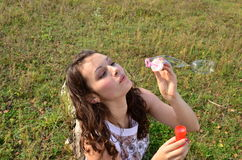 Girl with soap bubbles Stock Photo