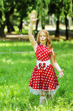Girl  with soap bubbles. Girl in a beautiful dress with soap bubbles Stock Image