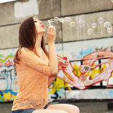 Girl with soap bubbles Stock Photography