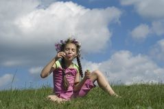 Girl with  soap bubbles I. Girl blowing  soap bubbles on green meadow Royalty Free Stock Images