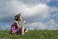 Girl with  soap bubbles III. Girl blowing  soap bubbles on green meadow Stock Images