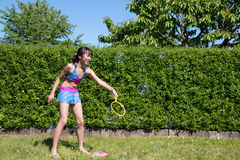 Girl with soap bubbles. Littly girl is playing with soap bubbles Royalty Free Stock Photography