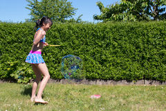 Girl with soap bubbles. Girl is playing with soap bubbles Stock Images