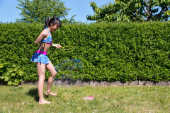 Girl with soap bubbles. Girl is playing with soap bubbles Royalty Free Stock Photography