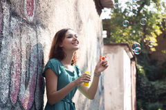 Girl and soap bubbles Royalty Free Stock Photos