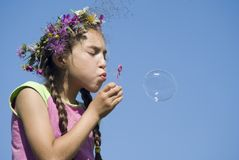 Girl with  soap bubbles VII. Girl blowing  soap bubbles on green meadow Stock Image
