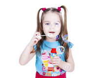Girl with soapy bubbles. Girl is blowing soapy bubbles isolated on white Royalty Free Stock Image