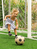 Girl with soccer ball Stock Images