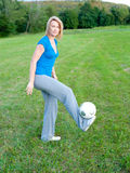 Girl with soccer ball. On a grass field in park Royalty Free Stock Photos