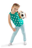 Girl with soccer ball. Cute little green-eyed girl with hair braided into a bun holds the mouse a soccer ball . Girl playing with boys in football-Isolated on Royalty Free Stock Photo