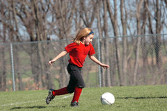 Girl at Soccer Field 18. Girl chasing soccer ball down the field Stock Images