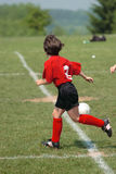 Girl at Soccer Field 26. Girl chasing soccer ball down the field Royalty Free Stock Photo