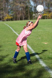 Girl at Soccer Field 45. Girl throwing ball onto soccer field during practice game Royalty Free Stock Images