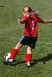 Girl at Soccer Field 45. Girl kicking ball down soccer field during game Stock Images