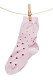 Girl sock hanging on clothesline Royalty Free Stock Photo