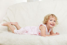 Girl on a sofa Stock Photos