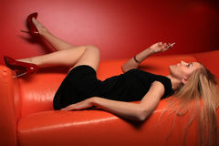Girl on sofa Stock Images