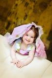 Girl on sofa royalty free stock photography